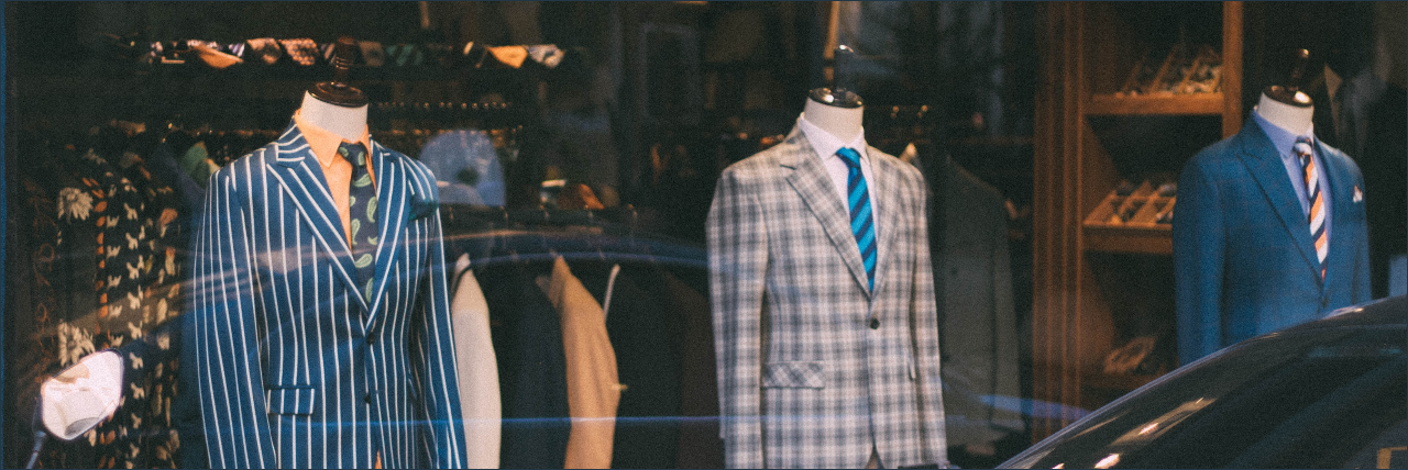 Bespoke custom clothing ready to wear shop image of suits at a store